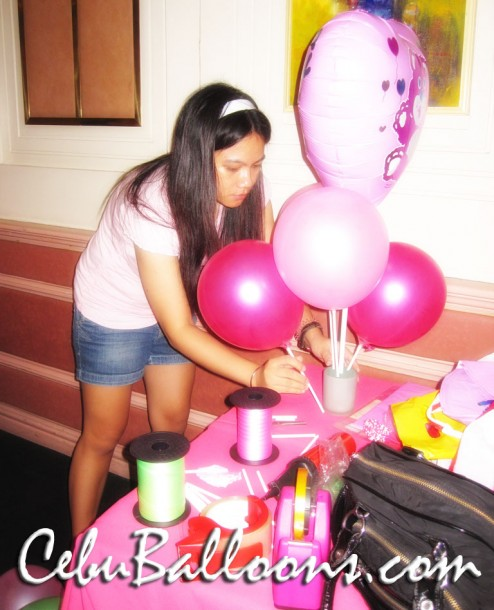 Busy working on a Balloon Centerpiece