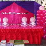 Baby Girl with Pacifier Balloon Decor at Metro Park Hotel Poolside