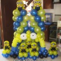 Columns with two-eyed Minions, Centerpieces with one-eyed Minions, & Cake Arch