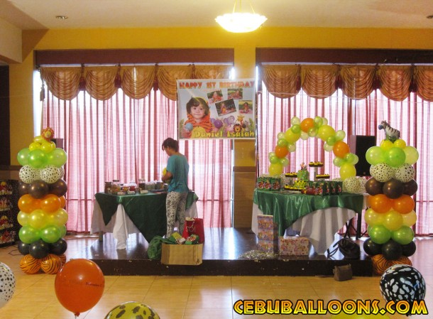 Safari Theme Balloon Columns & Cake Arch at Hannah's Party Place
