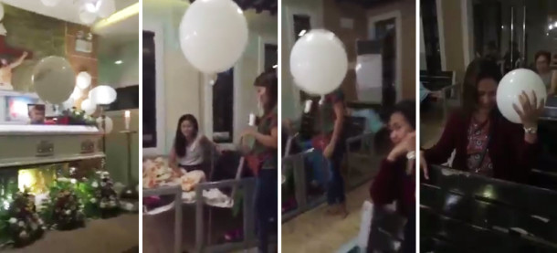Dead Baby in a Balloon Hugging & Kissing a Mom