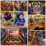 Superman-themed Balloon Setup with Party Supplies at One Oasis